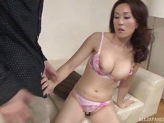 Japanese brunette housewife Shizuka Akiyama strips together with sucks cock