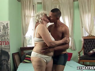 Granny Norma takes young boy's enduring cock